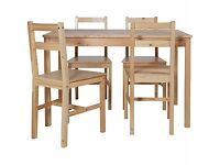 Solid wood untreated dining table and four chairs