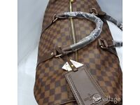 Louis Vuitton brown check travel bag
