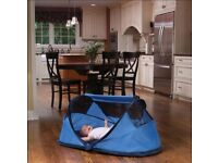 Baby pop-up travel cot, blue. Like new, excellent condition. Indoor or outdoor.