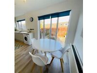 Round white dining table and 4 chairs