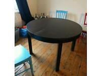 Extendable dining table (IKEA - Bjursta), black, used