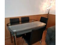 Black Glass Dining Table With Glass Shelf & 4 Chairs