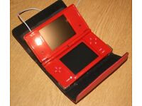Red Nintendo DSi with box, red case, charger and 8 games