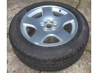 Car tyre 225/55 R17 97W with aluminium wheel used as coffee table (glass top)