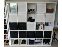IKEA Kallax 5x5 shelving unit with drawers and glass doors