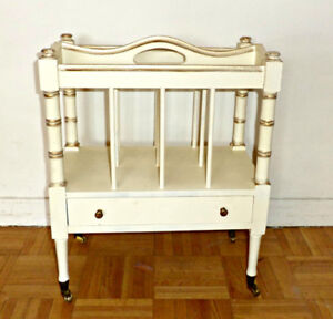 A rare antique magazine rack w drawer and brass casters