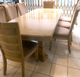 Light oak wood dining table and chairs