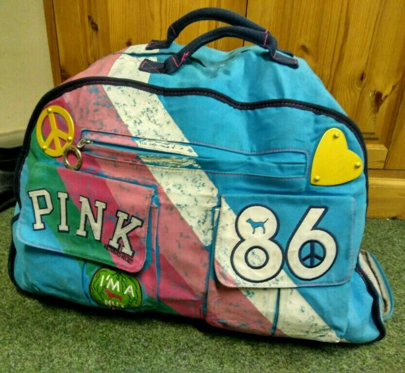 Victoria Secret pink rare bag rolling luggage travel duffle