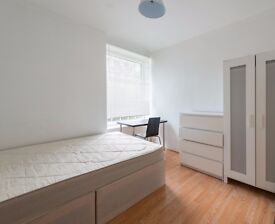 Double Bed in Room to rent in a 5-bedroom flat with central heating in Greenwich