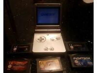 Silver Gameboy Advance SP and 5 games