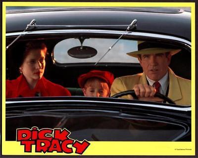 Warren Beatty Annette Bening Charlie Korsmo in car Dick Tracy movie photo 1062](Charlie Warren)