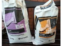 Part opened Bags of Plaster