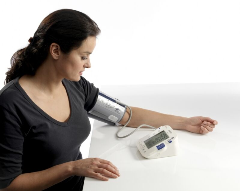 Taking your blood pressure is simple, easy and could end up saving your life! This lady is using the Omron M10-IT.