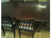 Wood dining table and chairs for sale.