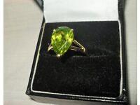 Diamond cut substantial size peridot stone set in 9 carat gold. Beautiful pear cut