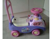 Pink sit and ride toy