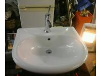 White wash basin and chrome monobloc mixer tap