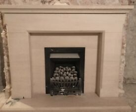 Limestone fireplace & inset living flame gas fire