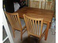 Oak Dining Table and Chairs. Very good condition.