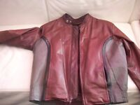 Funky tri-colour leather bike jacket. Detachable furry lining. Size Medium.