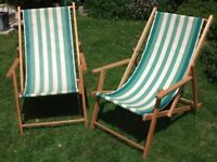 A pair of traditional wooden folding Deck Chairs Beach Chairs