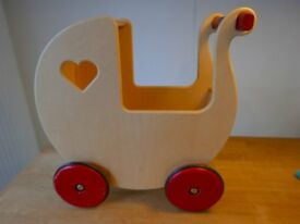 Wooden doll's pram from Moover, natural wood colour