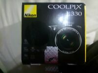 Nikon Coolpix L330 Digital Camera with strap, box, warranty, software disc and user guide