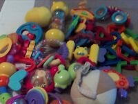 Collection of baby toys including rattles, letters, soft balls etc. 17 items.