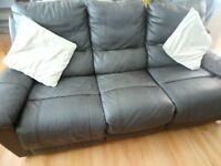 Recliner leather brown sofa.