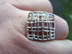 Solid silver modernist grid ring, stamped 925 plus makers marks.