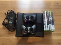 Xbox 360 with games and controllers including skylanders