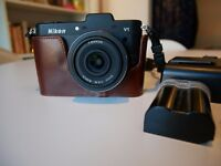 Nikon 1 V1 - 10mm f2.8 lens - leather case, charger + spare battery, lens mount and 16GB sd card!