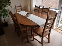 Large oval pine dining table and six chairs