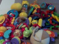 Selection of over fourteen different baby rattles and toys,