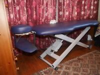 Electric massage couch. Height adjustable, little used and in good condition.