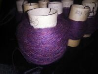 Yarn for craft work. yarn for weaving. Tapestry. Needlework.Small cones of yarn.
