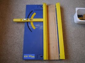 Cross cut and mitre guide for cutting sheet material with circular saw.