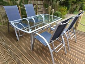 Large glass garden table and 4 reclining chairs