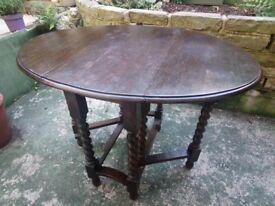 Vintage dark oak wooden drop-leaf extending dining table, with barley twist turned/carved legs