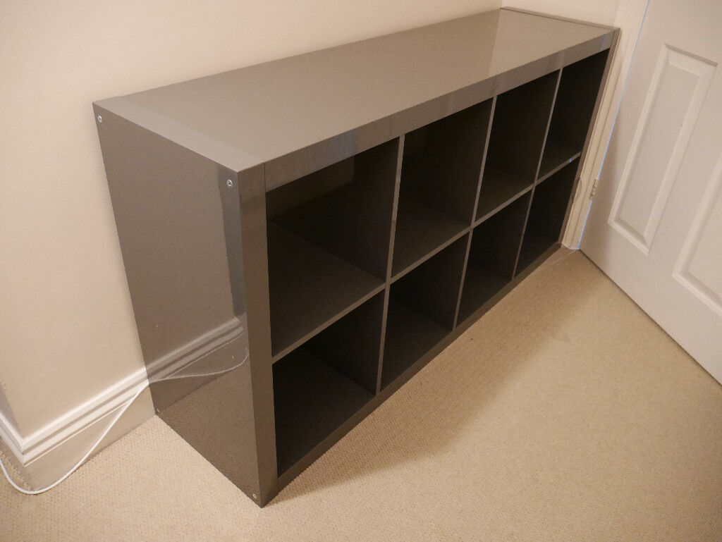 Ikea Expedit/Kallax 4x2 shelves in grey.