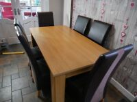 Wooden dining table with 6 chairs selling due to kitchen renovation