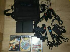 Play station 2 complete console with games memory card controllers and carry