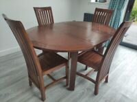 Set of 4 solid teak dining chairs and extending dining table