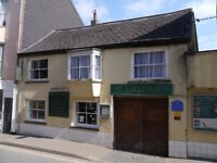 Restaurant with Rooms for lease in busy Devon market town with owners flat and large courtyard.