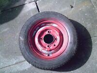 old caravan wheel and tyre