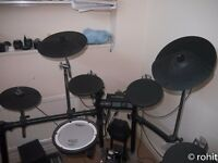 Roland TD4 drum kit with stool.
