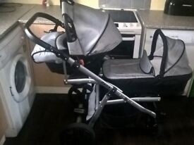 Twin tandem pushchair travel system