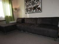 Brown corner sofa-bed