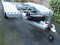 BORO FOUR WHELL CAR TRANSPORTER, MOUNTED SPARE. USED ONCE