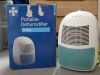 New portable dehumidifier, excellent condition